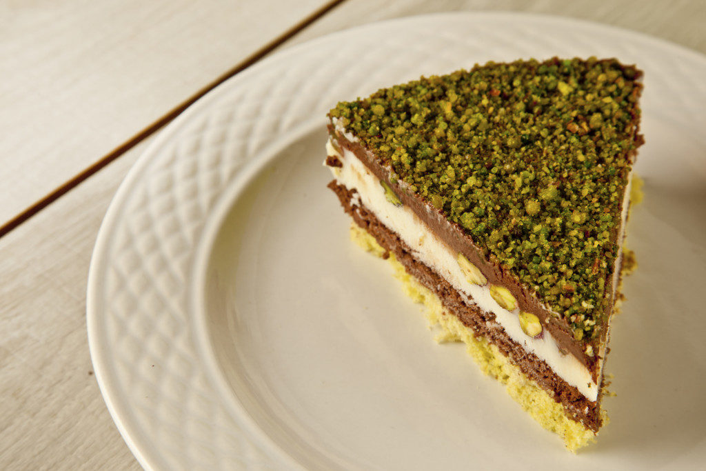 Pistachio cheesecake, decoration on a white plate